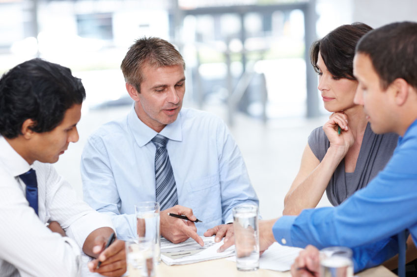 Human Resource professionals talk during meeting